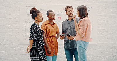 Buy stock photo Shot of a group of designers having a discussion in the office