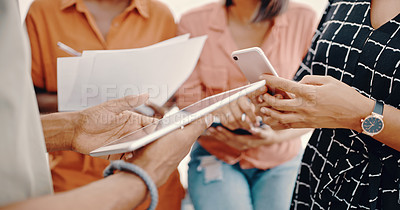 Buy stock photo Cropped shot of a woman using a digital tablet while in a meeting with colleagues