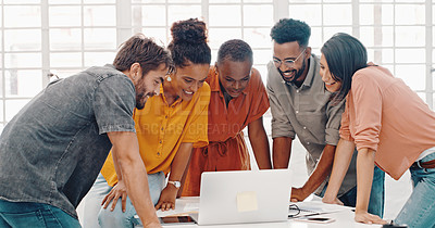 Buy stock photo Shot of a group of designers using a laptop during a brainstorming session