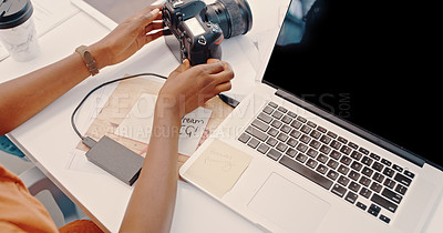 Buy stock photo Cropped shot of an unrecognizable businesswoman sitting with a camera and laptop