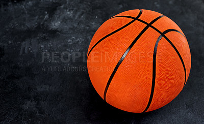 Buy stock photo High angle shot of a single basket ball placed on top of a dark background inside of a studio