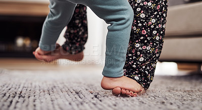 Buy stock photo Cropped shot of an unrecognizable mother and daughter dancing together in the living room at home