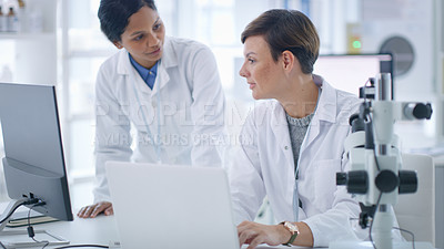 Buy stock photo Shot of two scientists having a discussion in a lab