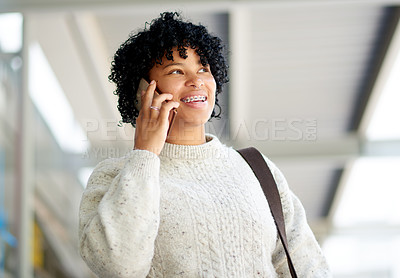 Buy stock photo Shot of a student talking on a cellphone while walking around campus