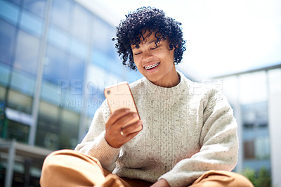Buy stock photo Shot of a student using a cellphone outside at campus