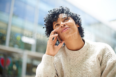 Buy stock photo Shot of a student talking on a cellphone outside at campus