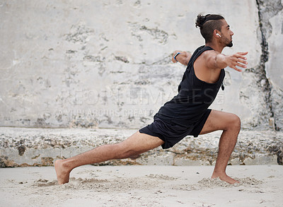 Buy stock photo Full length shot of a handsome young man exercising and practicing yoga outdoors
