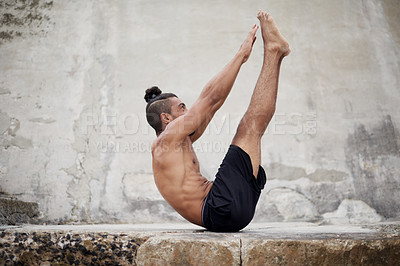 Buy stock photo Full length shot of a handsome young man stretching and exercising outdoors