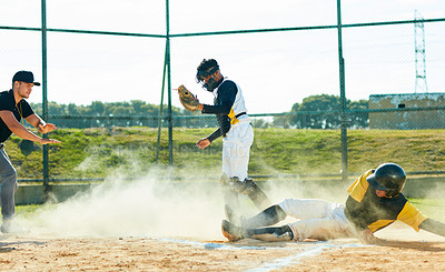 Buy stock photo Full length shot of a young baseball player reaching base during a game on the field