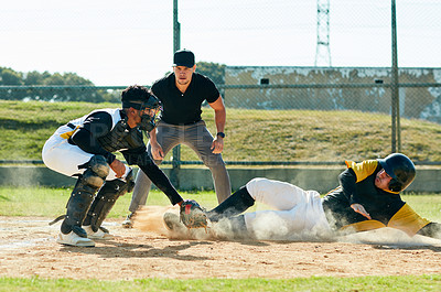 Buy stock photo Cropped shot of a young baseball player reaching base during a match on the field