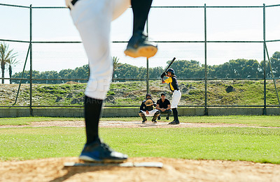 Buy stock photo Cropped shot of a young baseball player batting a ball during a match on the field