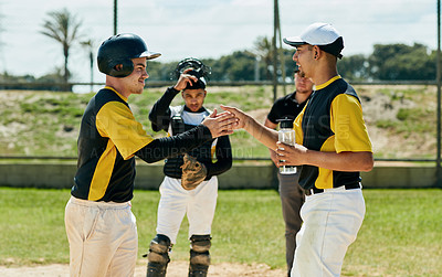 Buy stock photo Cropped shot of two handsome young baseball players cheering while standing on the field during the day