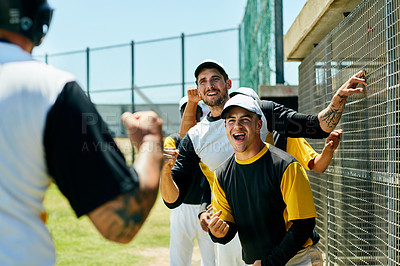 Buy stock photo Cropped shot of a group of young baseball players cheering while standing near a baseball field during the day