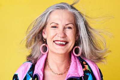 Buy stock photo Portrait of a cheerful and stylish senior woman posing against a yellow background