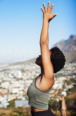 Buy stock photo Cropped shot of an attractive young woman practicing yoga while standing outdoors during the day