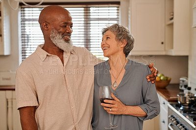 Buy stock photo Cropped shot of an affectionate and happy senior couple spending time together at home