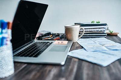 """Buy stock photo Shot of a laptop and a sticky note saying """"tax time"""" stuck to it"""
