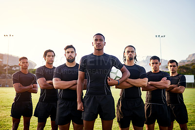 Buy stock photo Cropped portrait of a diverse group of sportsmen standing together before playing rugby during the day