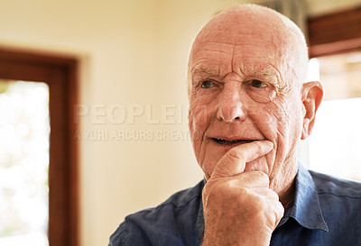 Buy stock photo Cropped shot of a senior man standing in his living room alone and looking contemplative while at home