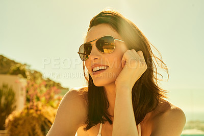 Buy stock photo Cropped shot of a beautiful young woman sitting outdoors on a sunny day