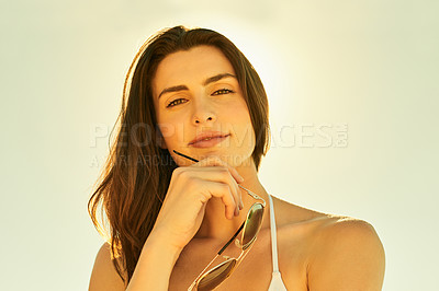 Buy stock photo Cropped shot of a beautiful young woman spending the day in the sun