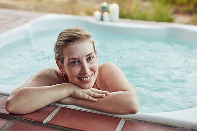 Buy stock photo Cropped portrait of an attractive young woman enjoying a relaxing day in a hot tub at the spa