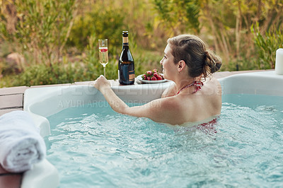 Buy stock photo Cropped shot of an attractive young woman enjoying a relaxing day in a hot tub at the spa