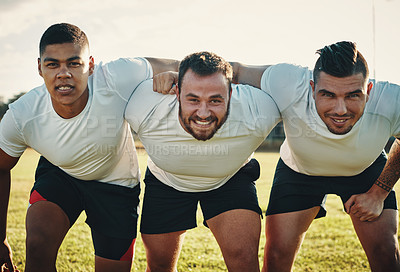 Buy stock photo Cropped portrait of a group of three young rugby players lining up for a scrum on the field during the day