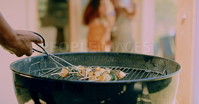 Buy stock photo Cropped shot of an unrecognisable man cooking kebabs on a barbecue grill