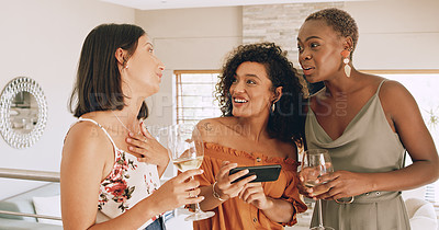 Buy stock photo Shot of a group of young friends using a smartphone together during a lunch party at home