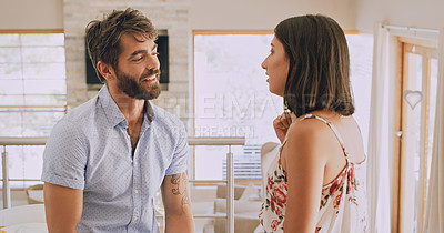 Buy stock photo Shot of a happy young couple chatting at home