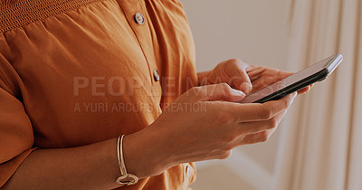 Buy stock photo Cropped shot of an unrecognisable woman using a smartphone at home