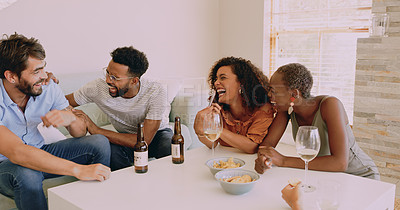 Buy stock photo Shot of a group of young friends using a smartphone while hanging out in the living room at home