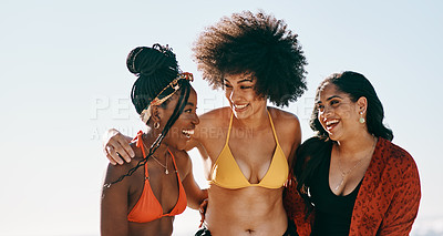 Buy stock photo Cropped shot of a young group of female friends bonding together during an enjoyable day on the beach