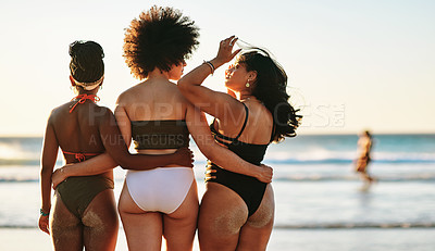 Buy stock photo Cropped shot of an unrecognizable group of friends standing together during a day out on the beach