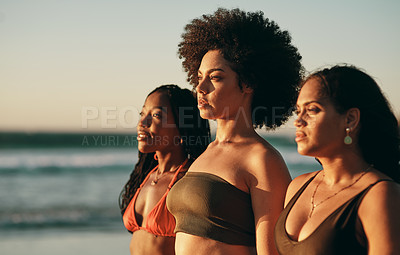 Buy stock photo Shot of three female friends standing together on the beach