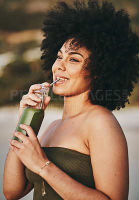 Buy stock photo Cropped shot of a beautiful young woman having a drink on the beach