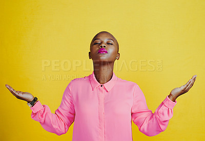 Buy stock photo Cropped shot of an attractive young woman meditating with her eyes closed against a yellow background