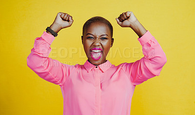 Buy stock photo Portrait of an attractive young woman screaming and cheering in studio against a yellow background