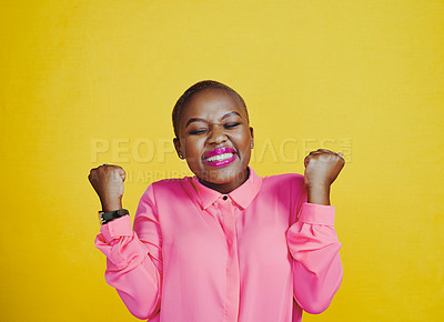 Buy stock photo Cropped shot of an attractive young woman feeling cheerful and excited against a yellow background