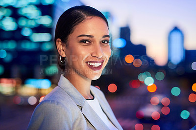 Buy stock photo Portrait of an attractive young businesswoman posing outdoors in the city at night