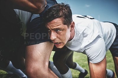 Buy stock photo Closeup of a focused young rugby player engaging in a scrum during a match outside on a filed