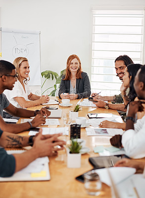 Buy stock photo Shot of a group of businesspeople having a meeting together in an office