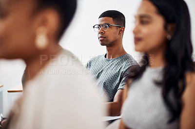 Buy stock photo Shot of a young businessman attending a conference