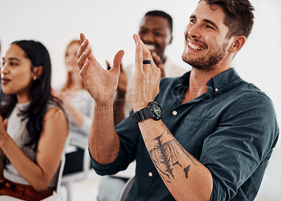 Buy stock photo Shot of a young businessman applauding during a conference