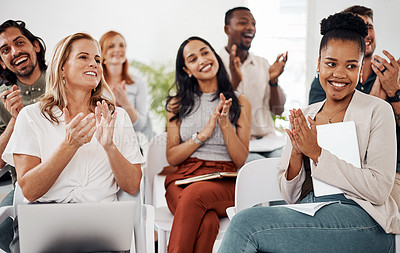 Buy stock photo Shot of a group of businesspeople applauding during a conference