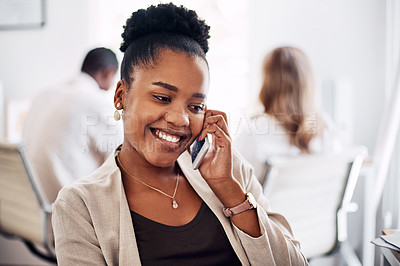 Buy stock photo Cropped shot of an attractive young businesswoman sitting in her office with her coworkers and using her cellphone