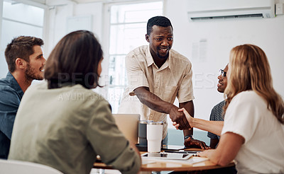 Buy stock photo Cropped shot of a diverse group of businesspeople having a meeting in the office together during the day