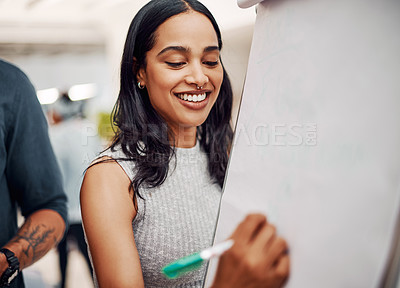 Buy stock photo Cropped shot of an attractive young businesswoman using a visual aid to brainstorm with her colleagues in the office