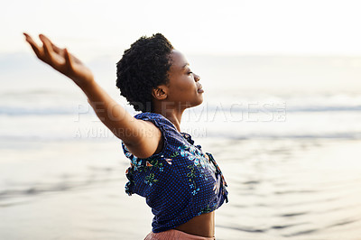 Buy stock photo Shot of a happy young woman enjoying a carefree moment at the beach